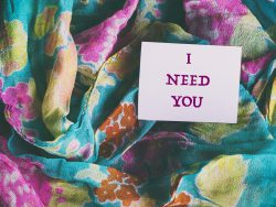 colorful silk scarf, words on white paper sticker i need you